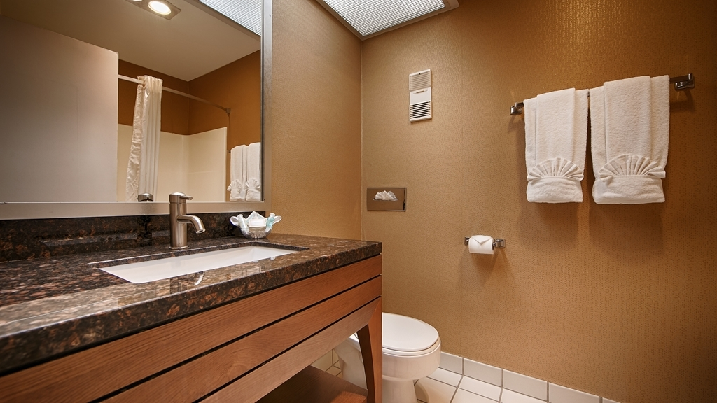 Best Western Inn at Palm Springs - All guest bathrooms have a large vanity with plenty of room to unpack the necessities.