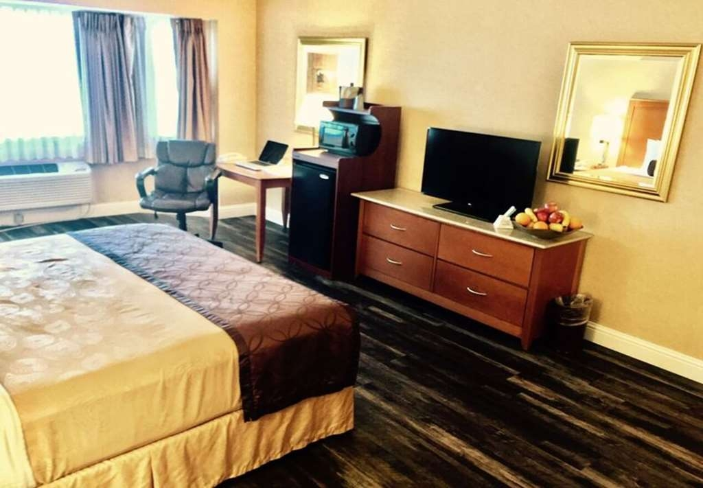 Best Western Plus Placerville Inn - One King Bed Business Plus Guest Room - Selective rooms have a wood floor.