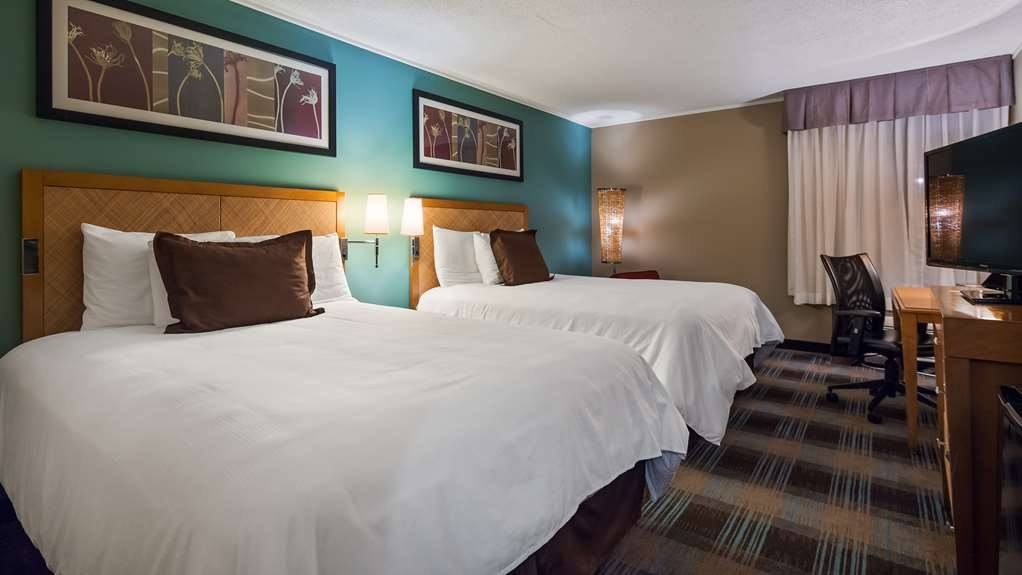 SureStay Plus Hotel by Best Western Jasper - If you're traveling with your family or group of friends, opt for our two queen bedroom.