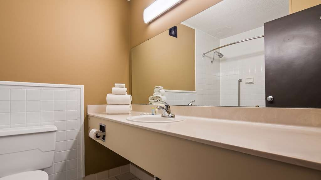SureStay Plus Hotel by Best Western Jasper - All guest bathrooms have a large vanity with plenty of room to unpack the necessities.