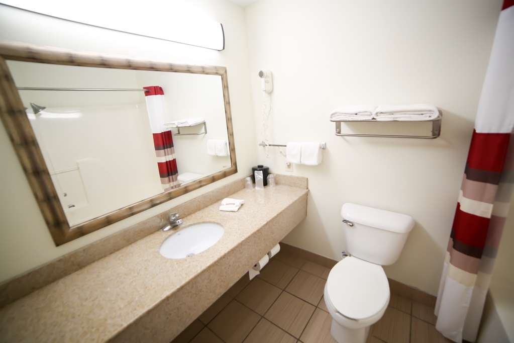 SureStay Plus Hotel by Best Western Evansville - All guest bathrooms have a large vanity with plenty of room to unpack the necessities.