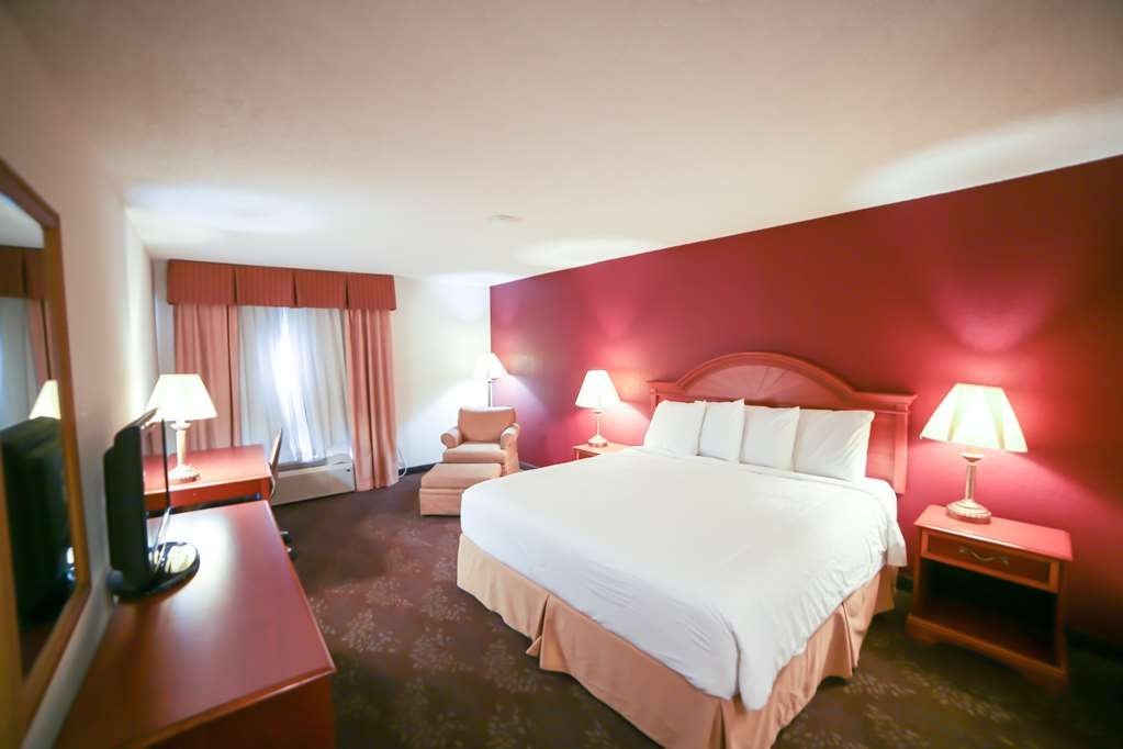 SureStay Plus Hotel by Best Western Evansville - Your comfort is our first priority. In our King with Chair and Ottoman, you will find that and much more.
