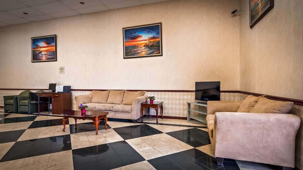 SureStay Hotel by Best Western Bellmawr - Our lobby is the perfect spot to relax after a long day of work and travel.