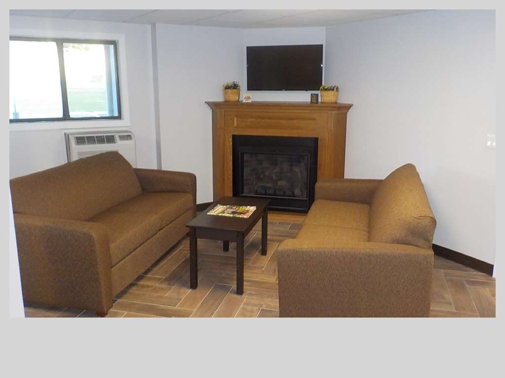 SureStay Hotel by Best Western Presque Isle - If you're here in the winter, keep warm by the fireplace in our hotel lobby.