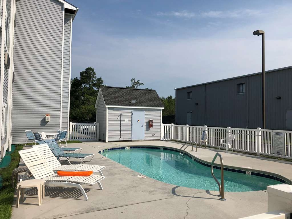 SureStay Hotel by Best Western Shallotte - The seasonal outdoor pool is perfect for swimming laps or taking a quick dip.