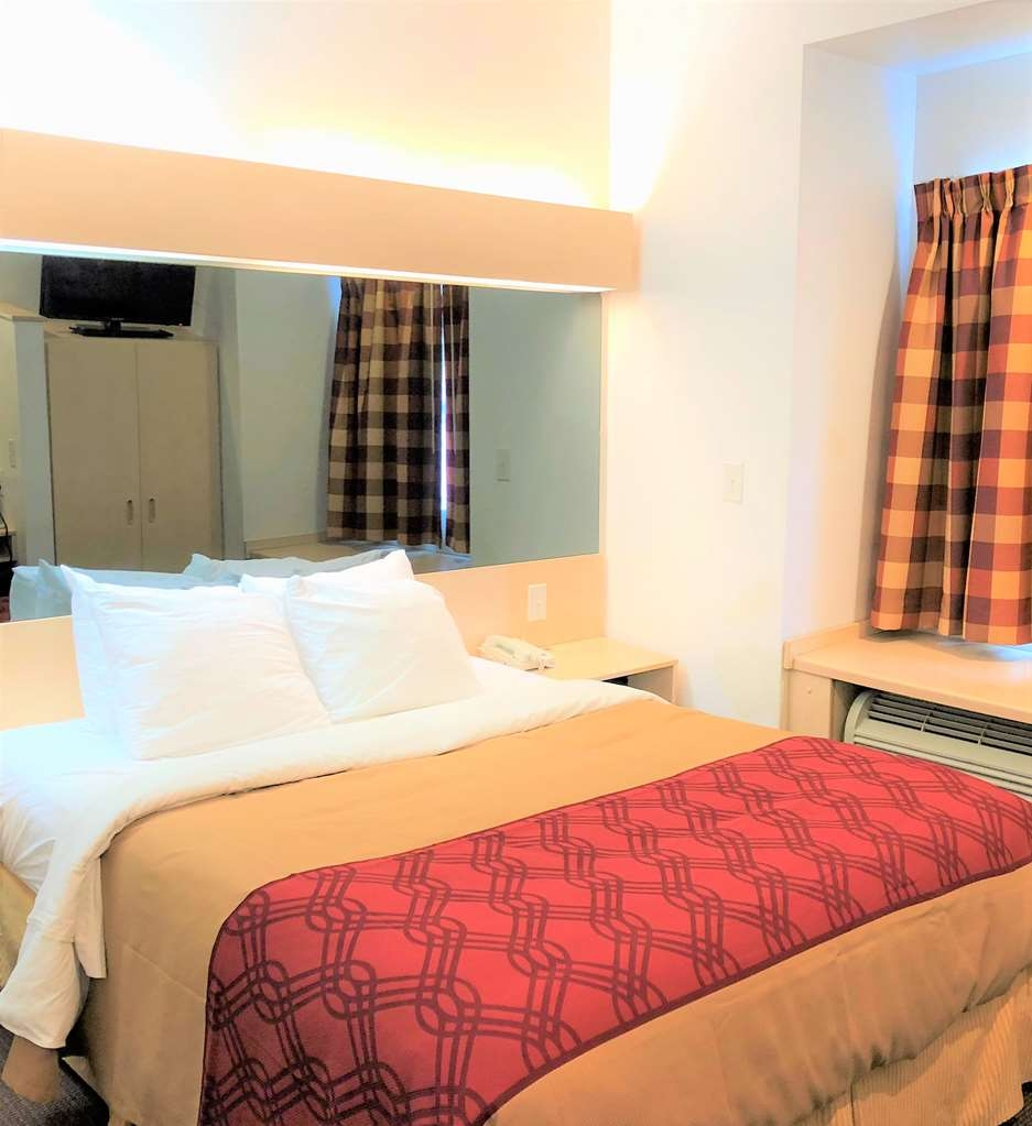 SureStay Hotel by Best Western Shallotte - Sink into our comfortable beds each night and wake up feeling completely refreshed.