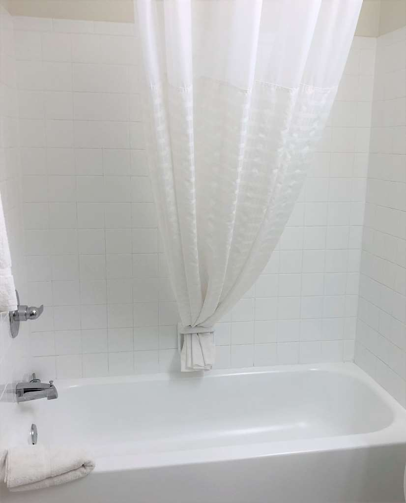 SureStay Hotel by Best Western Shallotte - After a long day of work and play relax the day away in our guest bathrooms.