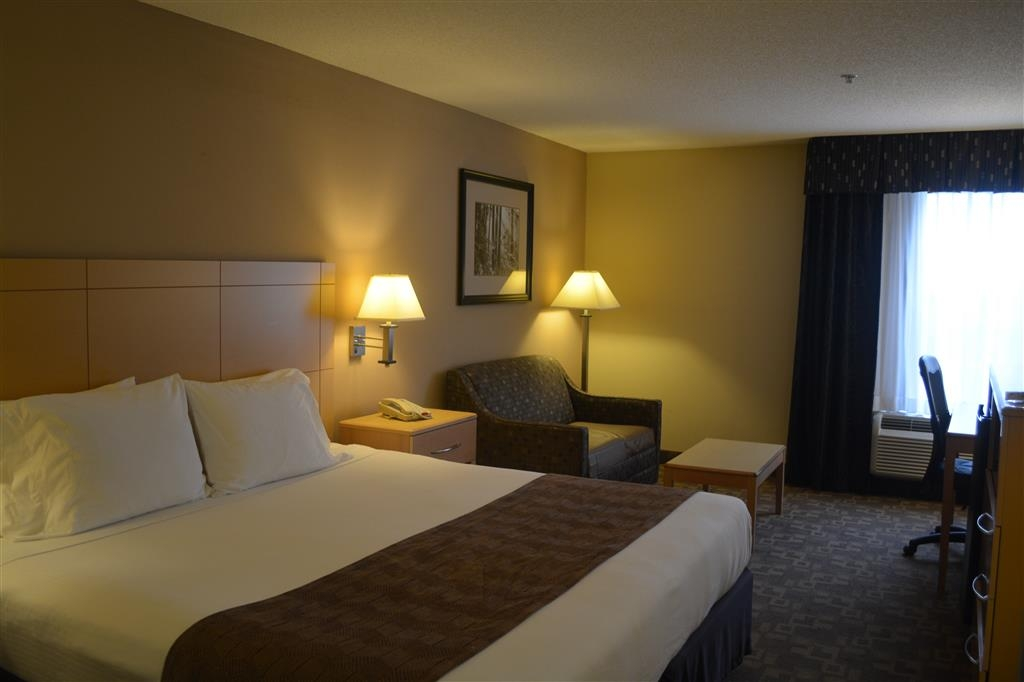 SureStay Plus Hotel by Best Western Roanoke Rapids - Stretch out and relax in this king executive room equipped with a sofabed, microwave, refrigerator and flat screen TV.