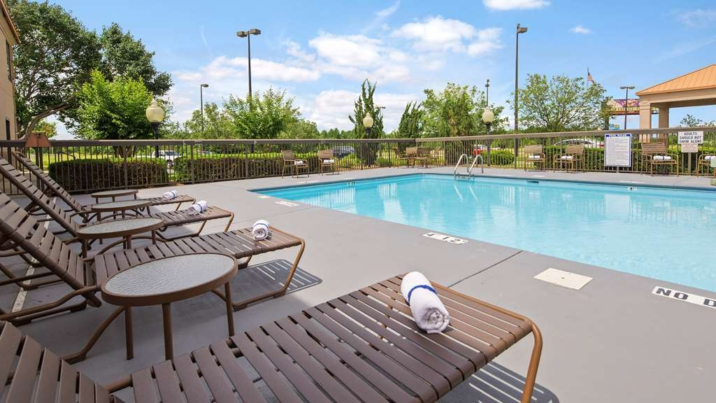 SureStay Plus Hotel by Best Western Roanoke Rapids - Take a refreshing dip or swim some laps in our outdoor pool.