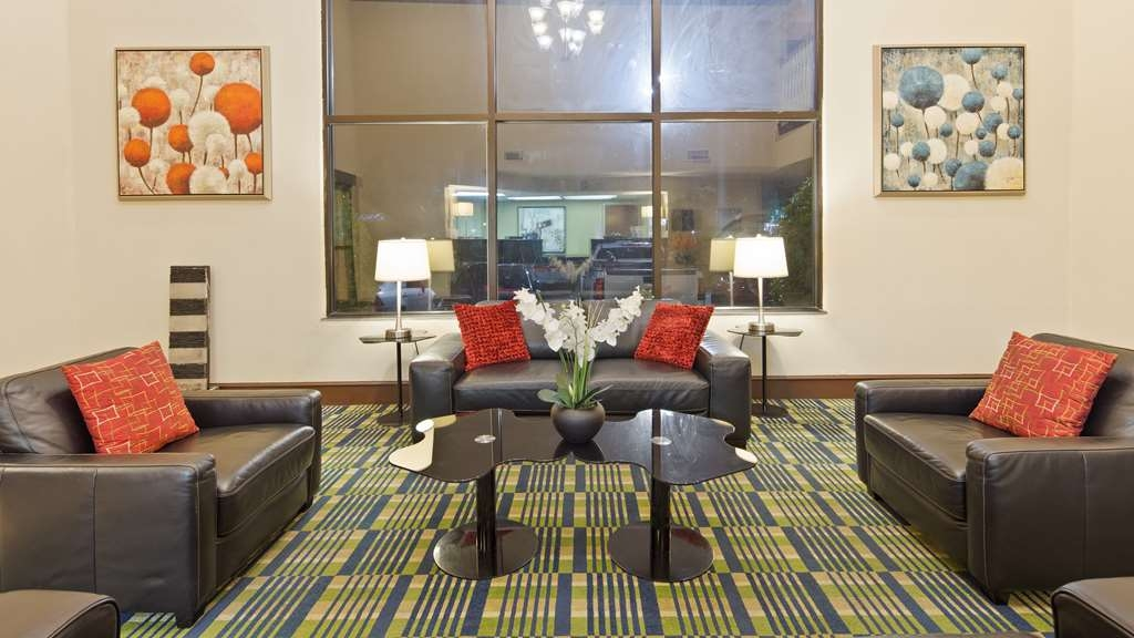 SureStay Plus Hotel by Best Western Roanoke Rapids - Our lobby is the perfect spot to relax after a long day of work and travel.