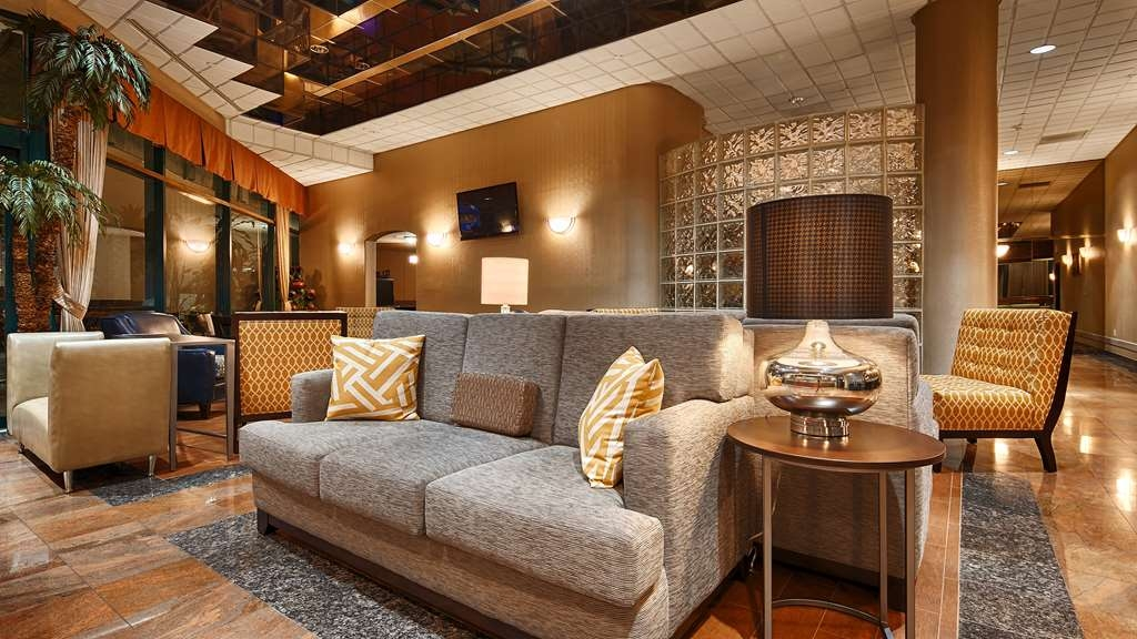 Best Western Plus Suites Hotel - Our lobby is the perfect spot to relax after a long day of work and travel.