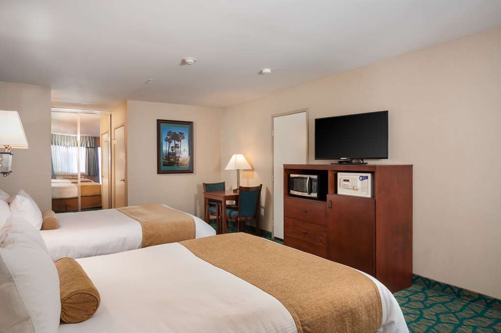 Best Western Plus Casablanca Inn - Remodeled standard two queen room includes new carpet, new lighting, new wall covering, and granite vanity.