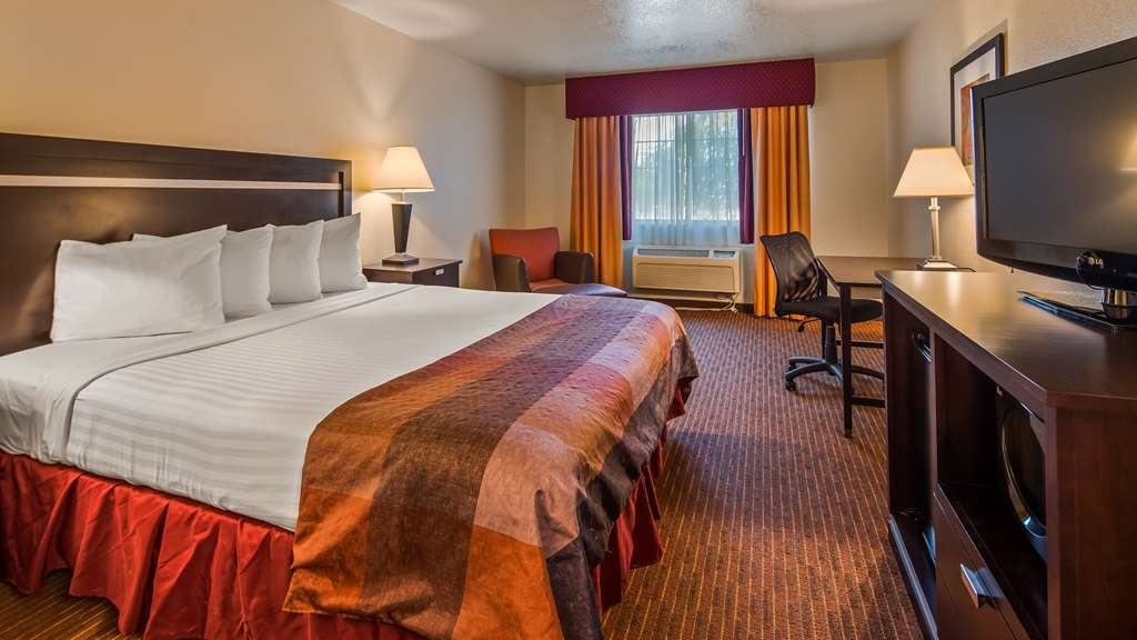 Best Western Luxury Inn - Pull back the covers, hop in and catch your favorite TV show in our Standard King Room.