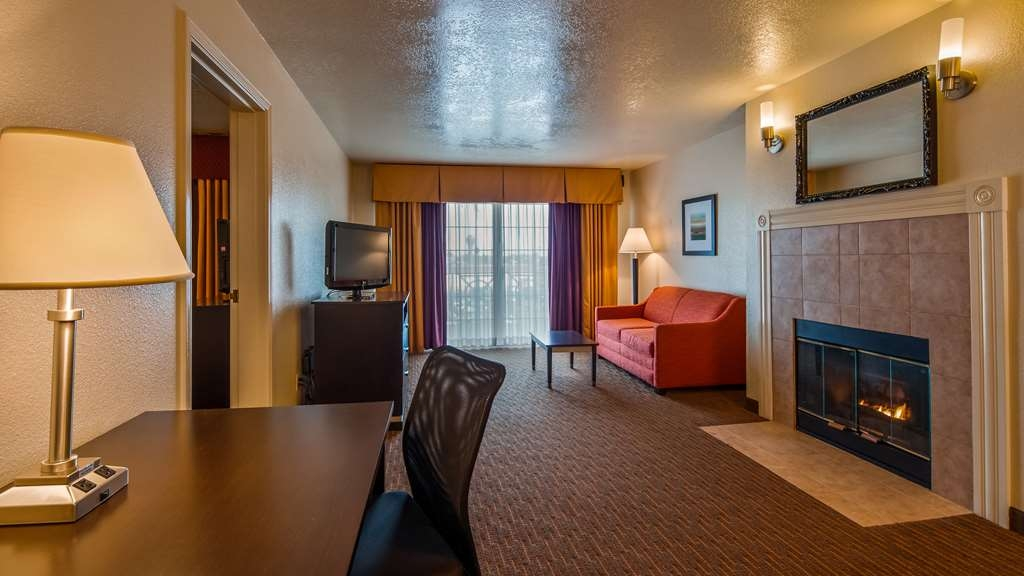 Best Western Luxury Inn - Spend some quality time together lounging by the fireplace features in our Luxury Suite.