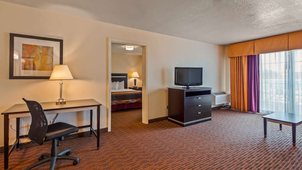 Best Western Luxury Inn - Use the separate living room in our Luxury Suite for entertaining, and keep your sleeping area private.