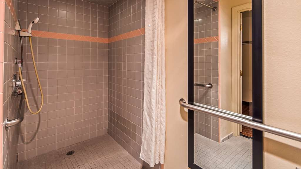 Best Western Luxury Inn - Our ADA mobility accessible bathroom is equipped with a shower chair and handheld shower head.