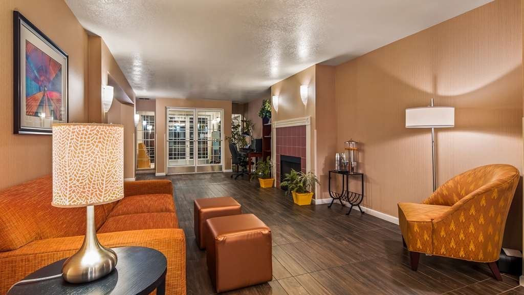 Best Western Luxury Inn - Stay warm by the fireplace or settle into one of the comfortable chairs.