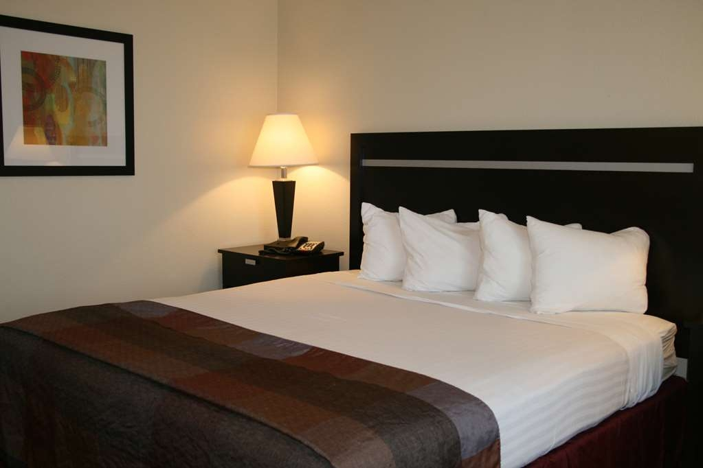Best Western Luxury Inn - Sink into our comfortable beds each night and wake up feeling completely refreshed.