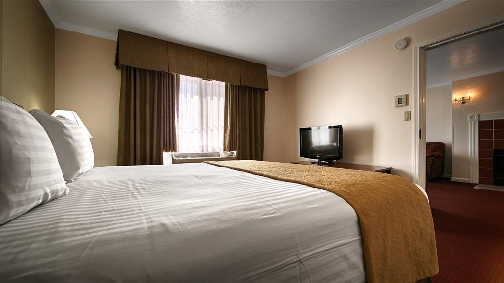 Best Western Salinas Monterey Hotel - Live in true luxury when you book a King Fireplace Suite.