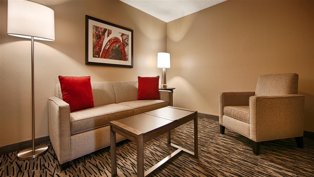 Best Western Los Alamitos Inn & Suites - Use the separate living room in our Double Queen Suite for entertaining, and keep your sleeping area private with a door that divides the living room area from the bedroom area.