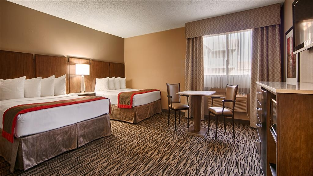 Best Western Los Alamitos Inn & Suites - Double Queen Suite - Bedroom area.
