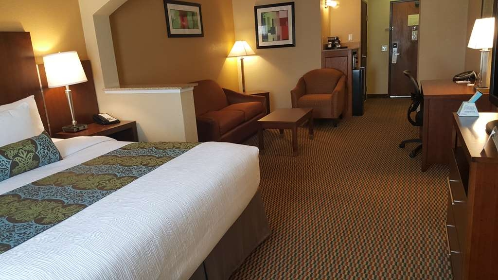 Best Western Plus Airport Inn & Suites - Sink into the comfort of our luxurious mattresses in our king suite.