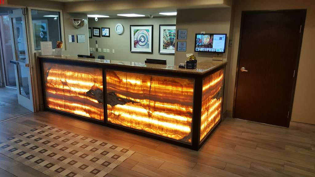 Best Western Plus Airport Inn & Suites - Begin your stay at our welcoming front desk.