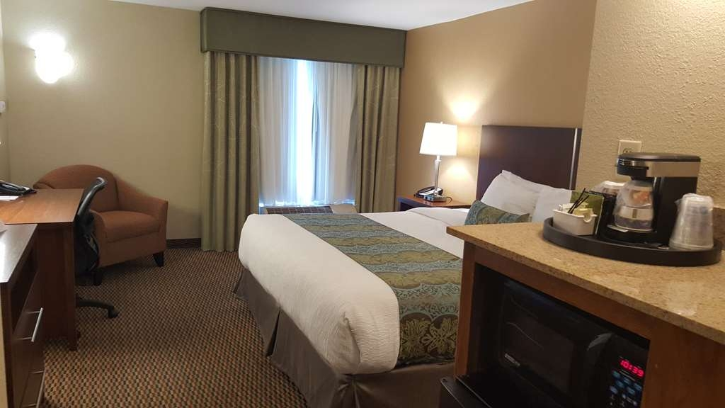 Best Western Plus Airport Inn & Suites - Make yourself at home in our king guest room.