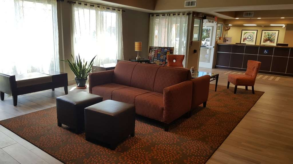 Best Western Plus Airport Inn & Suites - Feel right at home in our lobby seating area.