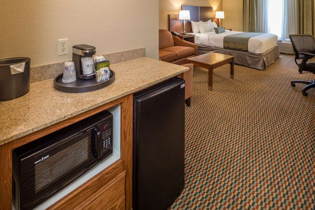 Best Western Plus Airport Inn & Suites - Our king guest room or suite offers a 42-inch LCD TV, microwave, refrigerator, coffee maker, wireless and hardwired internet access.