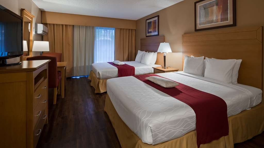 Best Western Plus Palm Desert Resort - This 2 queen guest room with 37-inch LCD TV, free Wi-Fi, refrigerator, coffee maker, iron/ironing board & safe also includes breakfast.