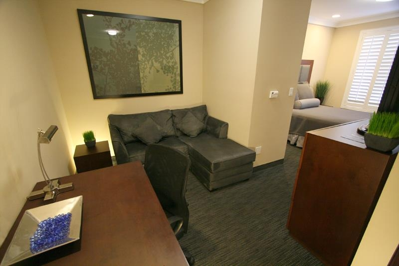 Best Western Plus Avita Suites - Studio Suite Living Room Area including Wet Bar, Microwave, Mini Fridge, Sofa w/ Chaise, and Large Work Desk