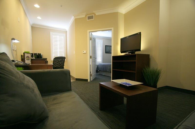 Best Western Plus Avita Suites - One Bedroom Suite Living Room Area including large Wet Bar, Microwave, Mini Fridge, Sofa w/ Chaise, and Large Work Desk