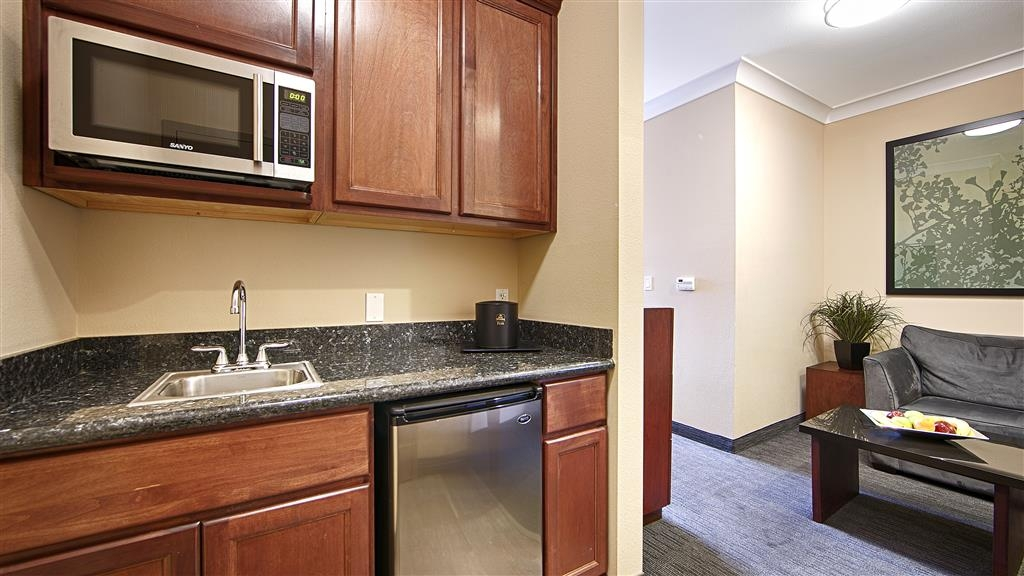 Best Western Plus Avita Suites - Living Room Area including large Wet Bar, Microwave, Mini Fridge, Sofa w/ Chaise, and Large Work Desk
