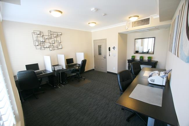 Best Western Plus Avita Suites - Business Center including two desktop station and two work desks.