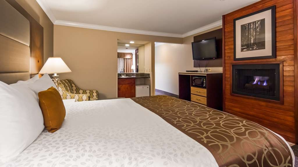 Best Western Plus Forest Park Inn - Spend some quality time together lounging by the fireplace featured in our king fireplace guest room. #Upgrade4theRomance #PureRelaxation #InstaRomance