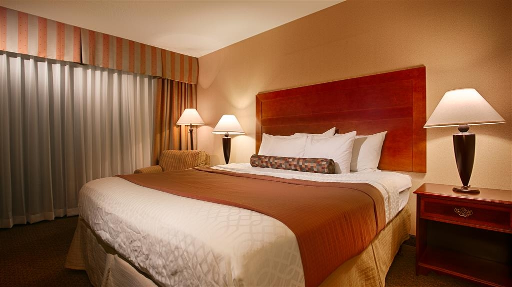 Best Western Plus Heritage Inn - Relax in front of your 32-inch LCD TV or enjoy a cool drink from your in-room refrigerator in our king guest rooms.