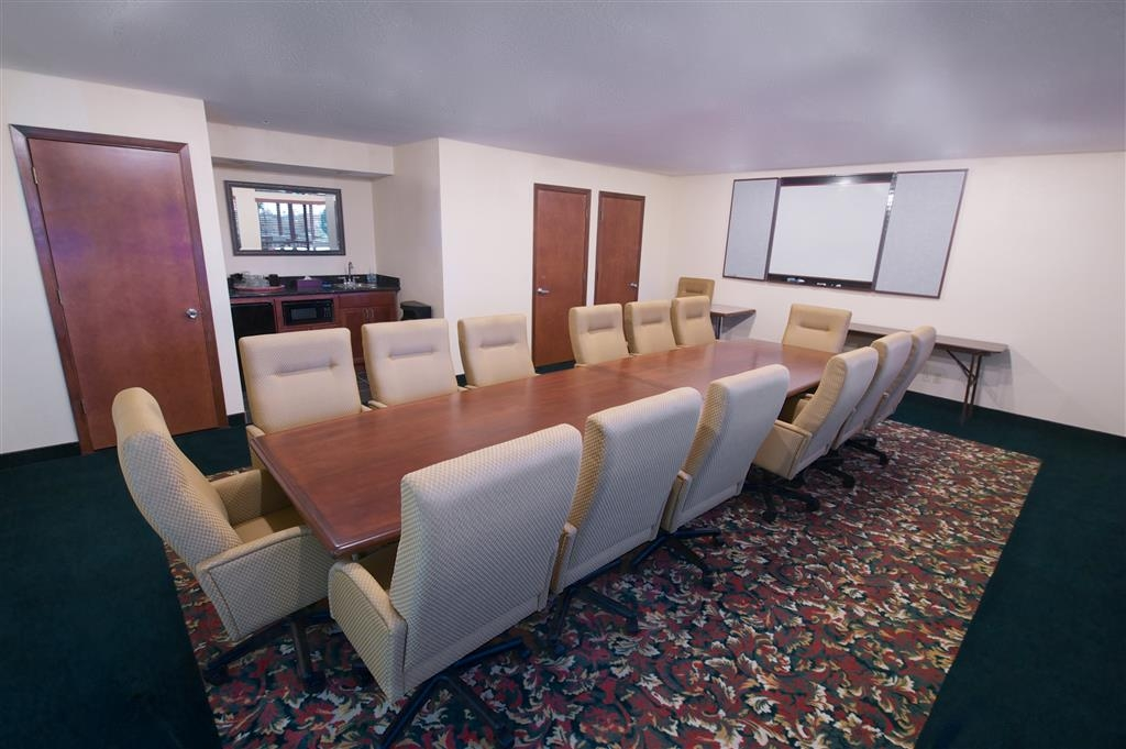 Best Western Plus Orchid Hotel & Suites - The Top of the Oak Boardroom features 14 high back cushioned chairs that fit comfortably around a large conference table.