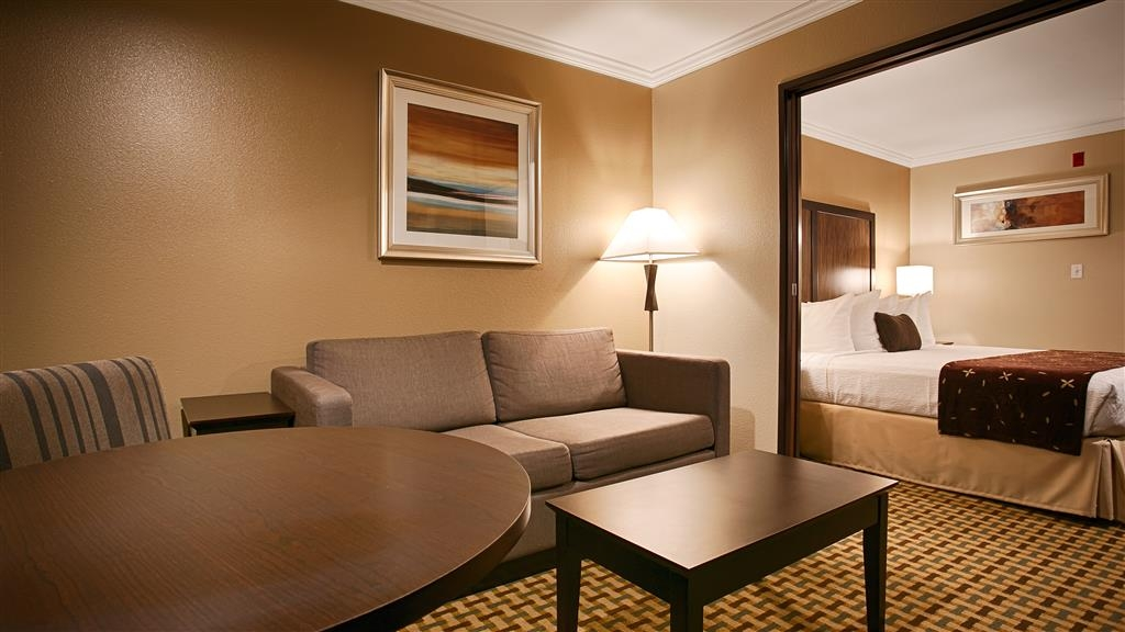 Best Western Plus Orchid Hotel & Suites - Our executive king suite has a living area separated by pocket door.