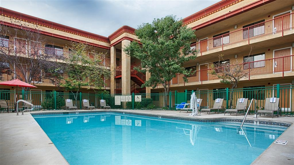 Best Western Plus Orchid Hotel & Suites - Our outdoor pool is the perfect place to rejuvenate after a day of traveling