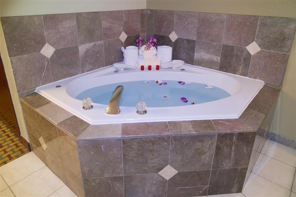 Best Western Plus Orchid Hotel & Suites - Enjoy our two person whirlpool tub inside the king spa guest room.