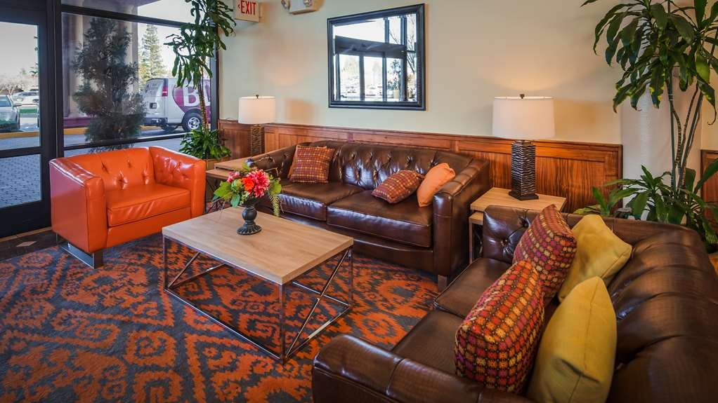 Best Western Plus Orchid Hotel & Suites - Business and leisure travelers alike will notice our beautiful lobby is the perfect refuge for today's active traveler.