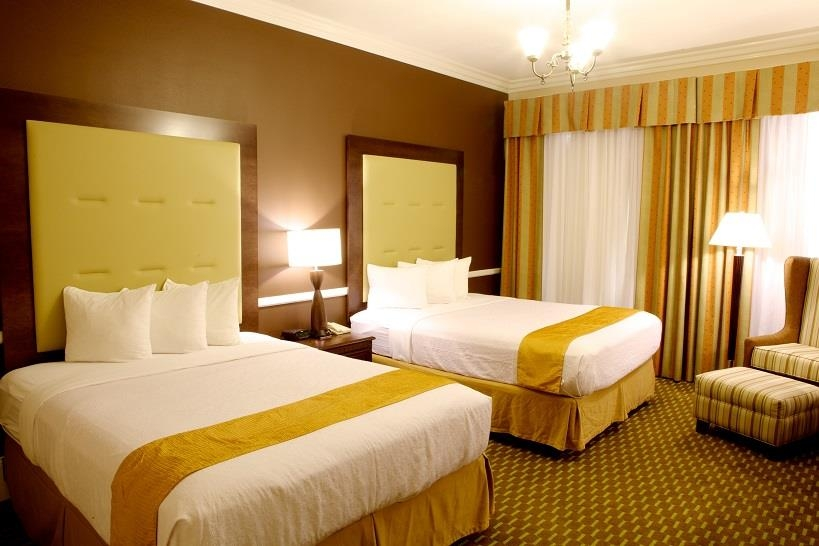 Best Western Plus San Pedro Hotel & Suites - Our two queen guest room has all the comforts of home including luxurious pillowtop mattresses and plush linen.
