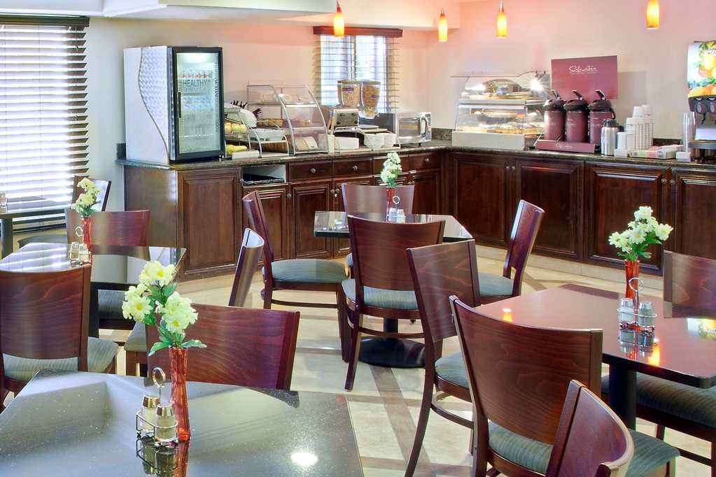Best Western Plus Marina Shores Hotel - Hot buffet breakfast includes: eggs, breakfast meat, potatoes, pancakes, cereal, yogurt, fresh fruit, and a variety of beverages including juice, coffee and tea.