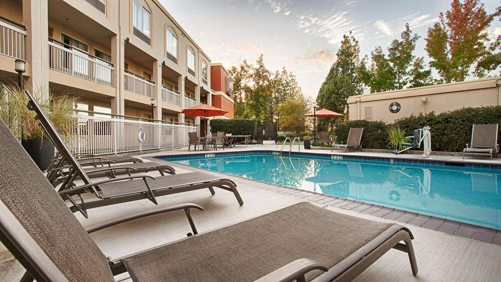 Best Western Plus Rancho Cordova Inn - Whether you want to relax poolside or take a dip our outdoor pool area is the perfect area to unwind.
