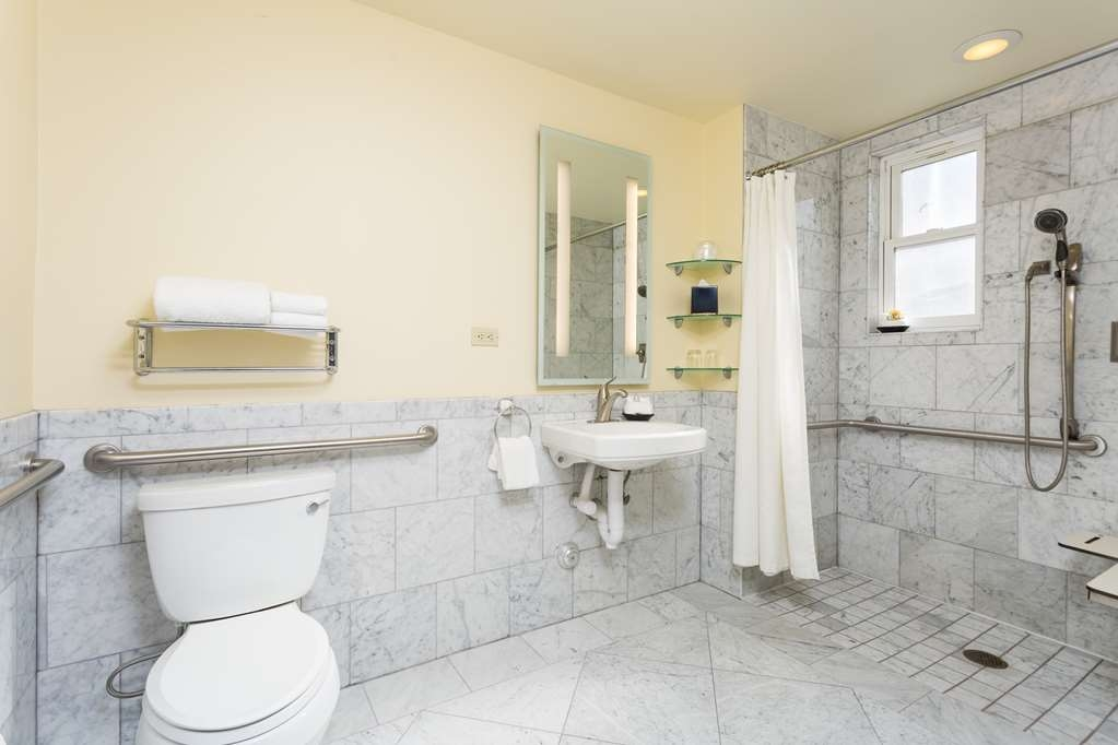 The Cartwright Hotel - Union Square, BW Premier Collection - Enjoy getting ready in the bathroom in the room with one twin bed and a roll-in shower.