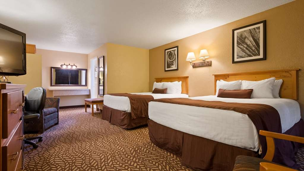 Best Western Turquoise Inn & Suites - Sink into our comfortable beds each night and wake up feeling completely refreshed.