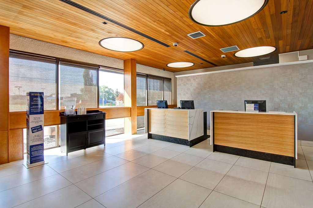 Best Western Cedar Park Inn - Relax in our lobby next to our cozy fireplace.