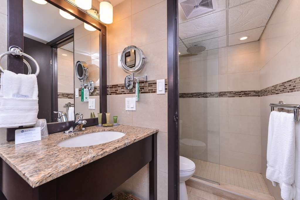 Best Western Wayside Inn - Our guest bathrooms offer plenty of extras like rainfall showers and lit makeup mirrors.