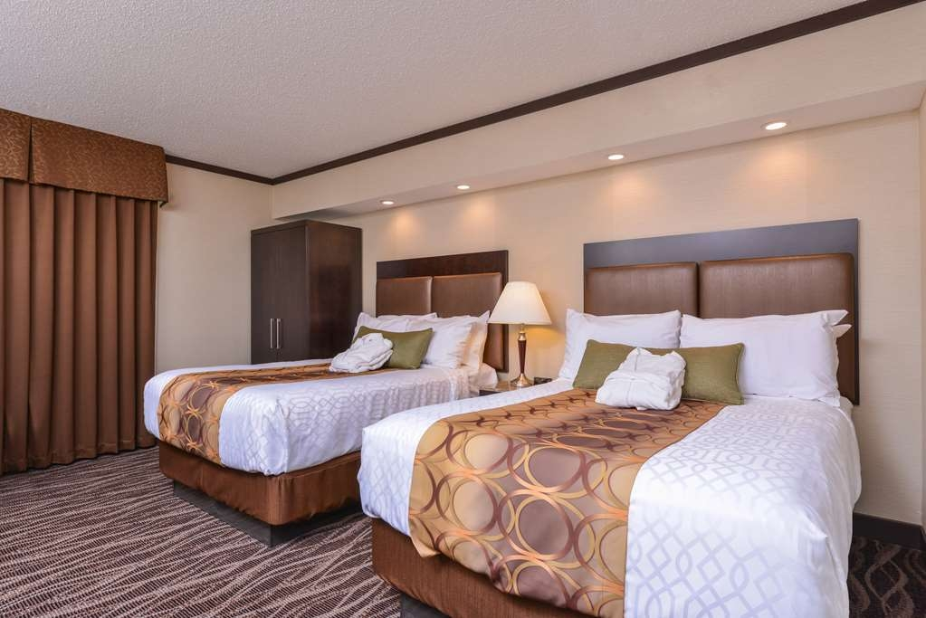 Best Western Wayside Inn - Our two double guest room offers two double sized beds, refrigerator, microwave, coffee station and walk-in shower with rain head shower.